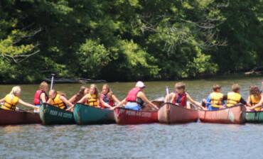line-of-kayaks-e1573842223465.jpg
